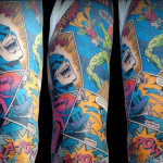 Incredible colorful Batman sleeve tattoo made by Ian Ink Tattoo.